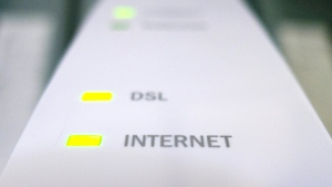 Internet and DSL lights are illuminated on a modem in Chelsea, Que., Monday July 11, 2011. (Adrian Wyld / THE CANADIAN PRESS)