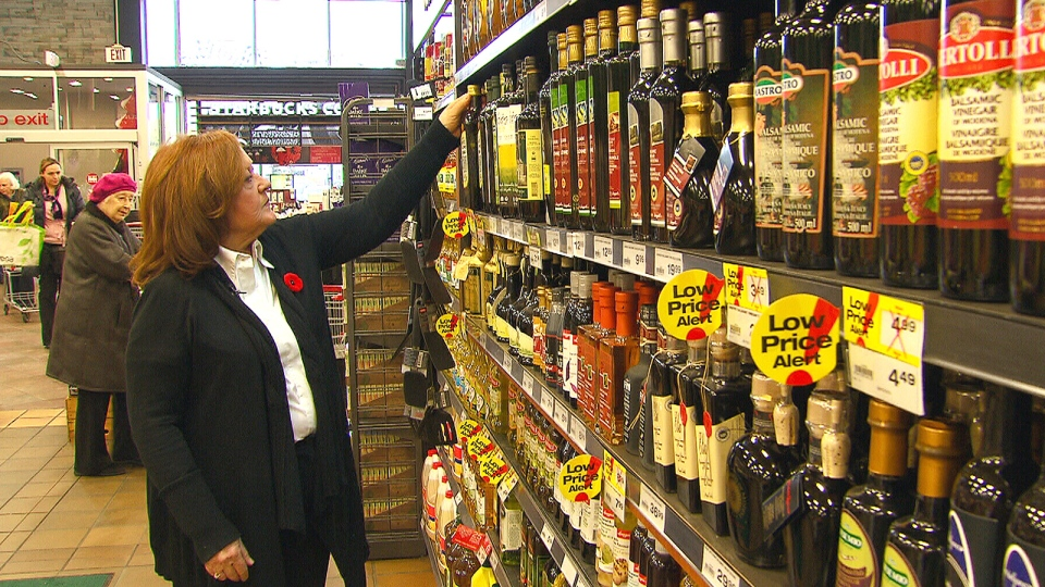 Dietitian Rosie Schwartz looks through the oil aisle at a grocery store.