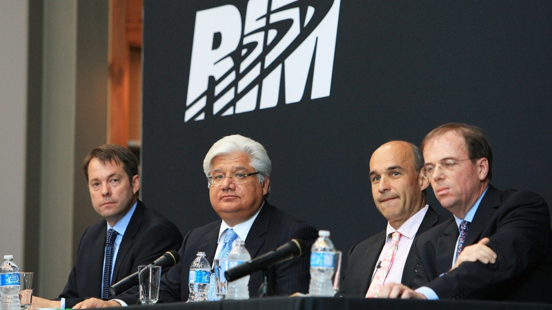 Grant Gardiner, left to right, co-chief executive Mike Lazaridis, co-chief executive Jim Balsillie and Rob Staley at the Research in Motion annual meeting in Waterloo, Ontario, Tuessday, July 12, 2011. (Dave Chidley / THE CANADIAN PRESS)