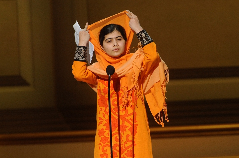 Education activist Malala Yousafzai accepts an award on stage at the 2013 Glamour Women of the Year Awards on on Nov. 11, 2013 in New York. (AP Photo/Invision/Brad Barket)