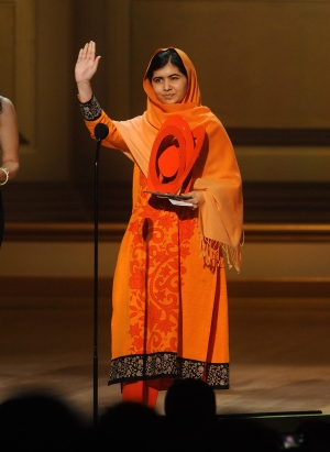 Teen activist Malala Yousafzai accepts an award on stage at the 2013 Glamour Women of the Year Awards on Nov. 11, 2013 in New York. (AP Photo/Invision/Brad Barket)