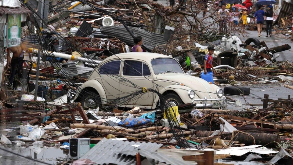Typhoon victims sift through the debris Tuesday, Nov. 12, 2013 in Tacloban city in Leyte province, central Philippines. (AP / Bullit Marquez)
