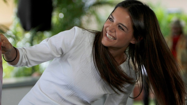 Actress Katie Holmes poses for photographers during a media event to promote her new movie 'Jack and Jill' in Cancun, Mexico, Sunday, July 10, 2011. (AP / Marco Ugarte)