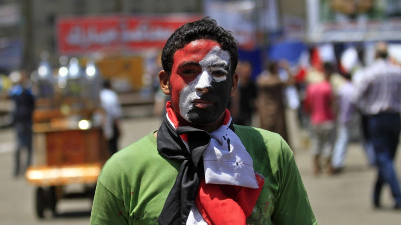 An Egyptian protester, his face painted in the colors of the Egyptian flag, protests at Tahrir Square in Cairo, Egypt, Tuesday, July 12, 2011. (AP Photo/Khalil Hamra)