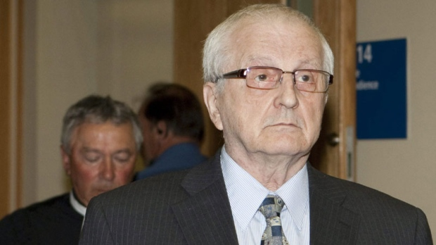 Rev. Raymond-Marie Lavoie walks outside for a lunch break at his trial in Quebec City, Monday, July 11, 2011 followed by his defence lawyer Serge Goulet. (THE CANADIAN PRESS/Jacques Boissinot)