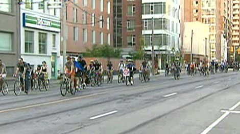 Toronto cyclists rally to demonstrate against the decision to remove bike lanes from three streets in Toronto, Wednesday, July 13, 2011.