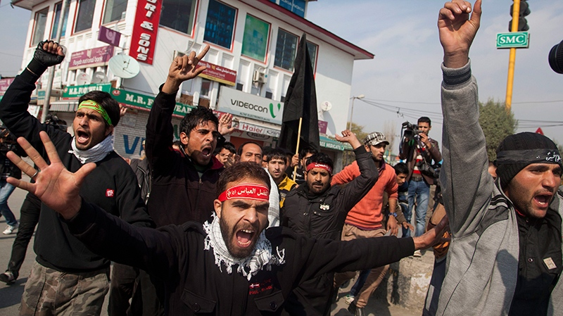 Kashmiri Shiite Muslims shout slogans after they were stopped by police during a Muharram procession in Srinagar, India, Wednesday, Nov. 13, 2013. (AP Photo/Dar Yasin)