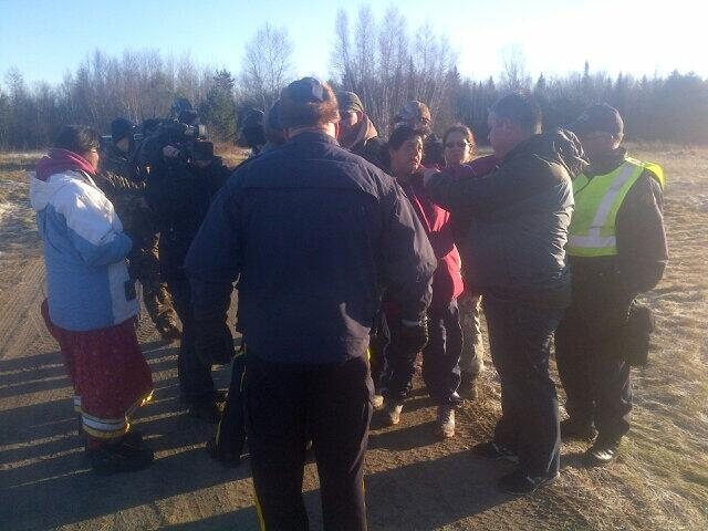 Shale gas protesters talk with RCMP officers along Route 11 near Laketon on Nov. 13, 2013. (CTV Atlantic)