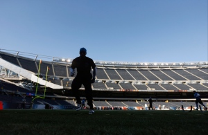 Detroit Lions wide receiver Calvin Johnson warms up before an NFL football game against the Chicago Bears in Chicago, Sunday, Nov. 10, 2013. (AP / Charles Rex Arbogast)