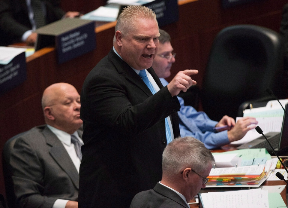 Coun. Doug Ford defends his brother, Mayor Rob Ford, at city council in Toronto on Wednesday, Nov. 13, 2013. (Nathan Denette / THE CANADIAN PRESS)
