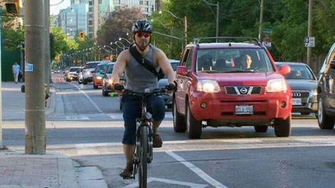 A cyclist using the Jarvis Street bicycle lanes.