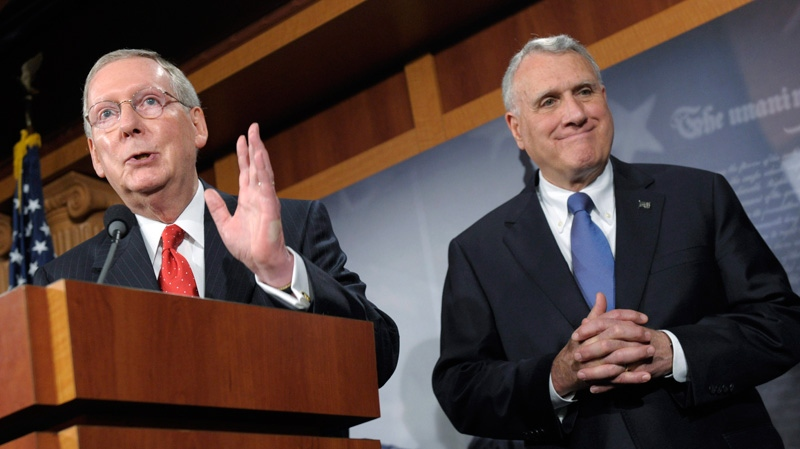 Senate Minority Leader Mitch McConnell of Ky., left, accompanied by Senate Minority Whip Jon Kyl of Ariz., gestures during a news conference on Capitol Hill in Washington, Tuesday, July 12, 2011. (AP / Susan Walsh)