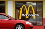 A car moves through a McDonald's drive through window line, in Springfield, Ill., on Oct. 17, 2011. (AP / Seth Perlman)