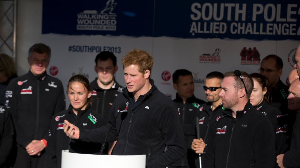 Prince Harry, centre, makes a speech on stage as he attends the 'Walking With The Wounded South Pole Allied Challenge' departure event in Trafalgar Square, London, Thursday, Nov. 14, 2013. (AP / Matt Dunham)