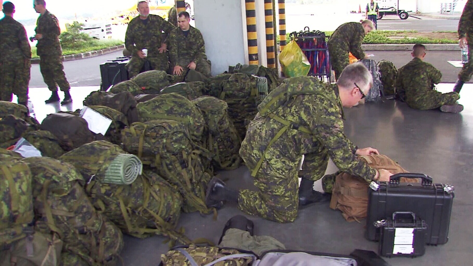 Canadian Forces arrive at an airport in Iloilo, Philippines on Friday, Nov. 15, 2013.