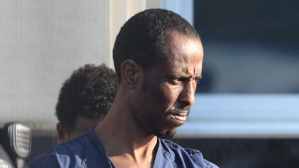 Suspected pirate <b>Ahmed Muse</b> Salad leaves the federal courthouse in Norfolk, <b>...</b> - image
