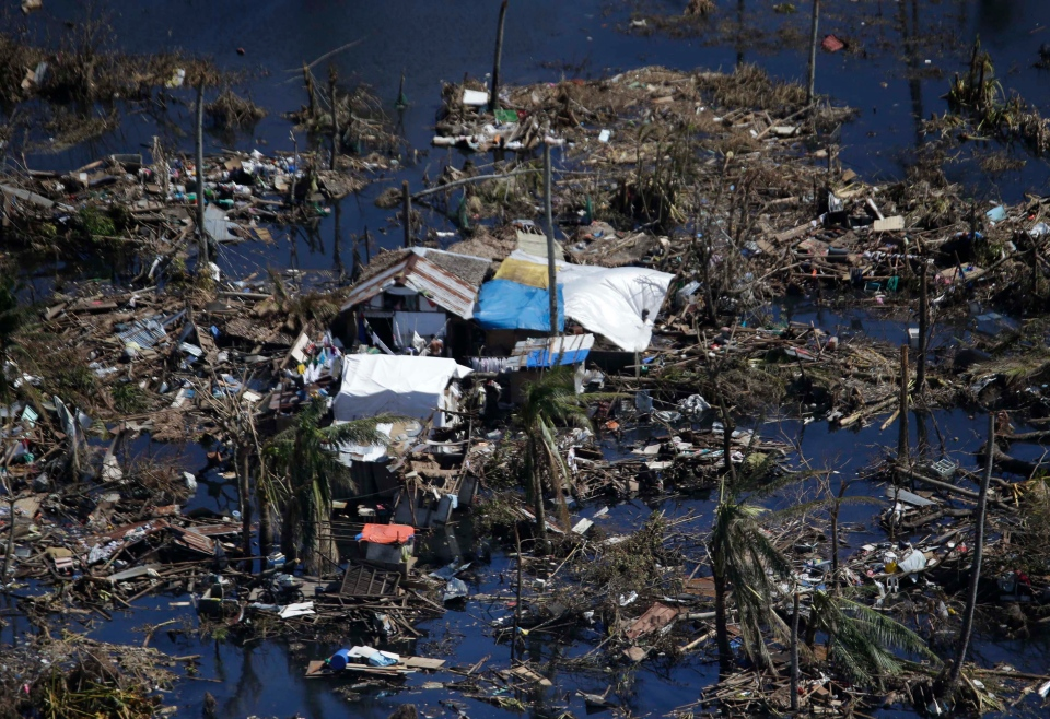 Debris litters the village amidst a temporary lake formed after Typhoon Haiyan, in Tacloban, central Philippines, Nov. 15, 2013. (AP / Bullit Marquez)