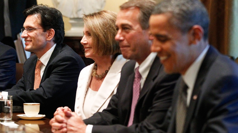 House Majority Leader Eric Cantor of Va., left, sits with President Barack Obama, right, House Speaker John Boehner of Ohio, second from right, and House Minority Leader Nancy Pelosi of Calif., as he meets with Republican and Democratic leaders regarding the debt ceiling, Thursday, July 14, 2011, in the Cabinet Room of the White House in Washington. (AP / Charles Dharapak)