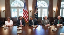 President Barack Obama, center, sits with from left, House Minority Leader Nancy Pelosi of Calif., House Speaker John Boehner of Ohio; Senate Majority Leader Harry Reid of Nev. and Senate Minority Leader Mitch McConnell of Ky. during a meeting with Republican and Democratic leaders regarding the debt ceiling, Thursday, July 14, 2011, in the Cabinet Room of the White House in Washington. (AP / Charles Dharapak)