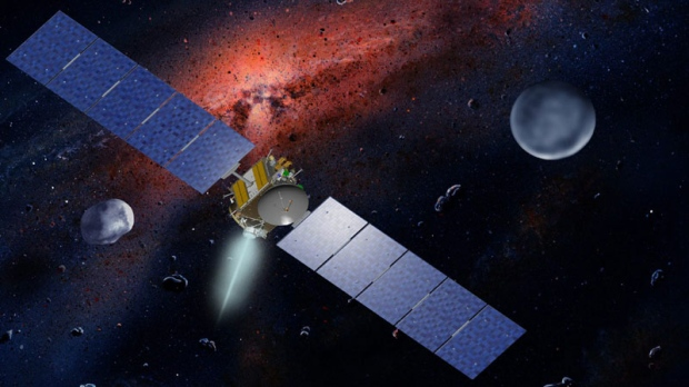 This undated artist's concept released by NASA and UCLA shows the Dawn spacecraft with Ceres and Vesta. After four years sailing through space, the Dawn spacecraft was expected to slip into orbit late Friday around a giant asteroid Vesta to begin a yearlong investigation into the origins of the solar system.