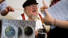 "Author George R.R. Martin appears at a book signing for ""A Dance with Dragons"" at Barnes & Noble in New York, Thursday, July 14, 2011. HBO's ""Game of Thrones,"" based on RR Martin's epic fantasy novels, was nominated for an Emmy for best drama series on Thursday."