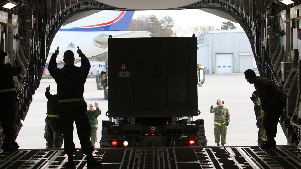 Canadian forces members load a C-17 Globemaster at CFB Trenton in Trenton, Ont., on Friday Nov. 15, 2013. (Lars Hagberg / THE CANADIAN PRESS)