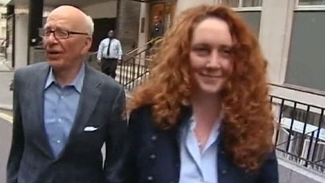 Chairman of News Corporation Rupert Murdoch, left, and Chief executive of News International Rebekah Brooks as they leave his residence in central London, Sunday, July 10, 2011.