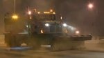 Snow plows were already out clearing Edmonton streets Friday night.