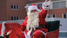 Santa Claus makes his annual appearance at the Kitchener-Waterloo Santa Claus Parade on Saturday, Nov. 16, 2013. (David Pettitt / CTV Kitchener)