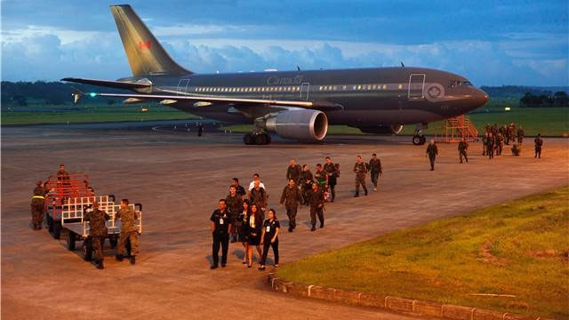 A Royal Canadian Air Force CC-150 Polaris aircraft with members of the Canadian Armed Forces Disaster Assistance Response Team (DART) onboard arrives in Iloilo city, Philippines on Nov. 16, 2013. (MCpl Marc-Andre Gaudreault, Canadian Forces Combat Camera)