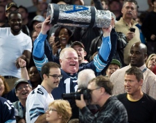 Rob Ford holding Grey Cup