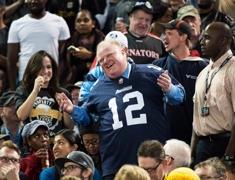 Toronto Mayor Rob Ford laughs with fans as he attends the Toronto Argonauts and Hamilton Tiger-Cats CFL Eastern Conference final football game in Toronto on Sunday, Nov. 17, 2013. (Nathan Denette / THE CANADIAN PRESS)