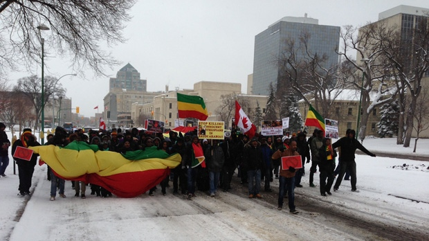 Dozens of people from Manitoba's Ethiopian community march up Memorial Boulevard to the Legislative Building.