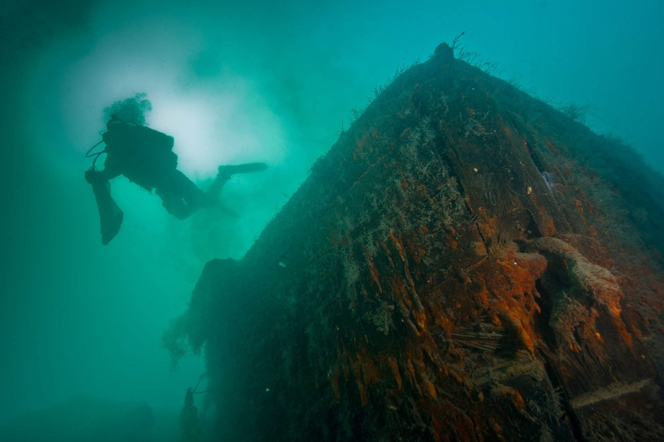 Parks Canada archaeologist swimming over the bow of HMS Investigator. The Canadian Press Images PHOTO/Parks Canada