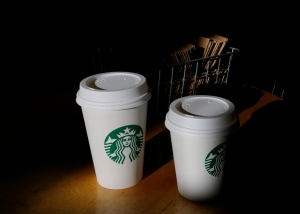 In this Wednesday, Oct. 23, 2013, file photo, cups of Starbucks coffee drinks sit on a counter at a Starbucks store, in Seattle. (AP / Ted S. Warren)