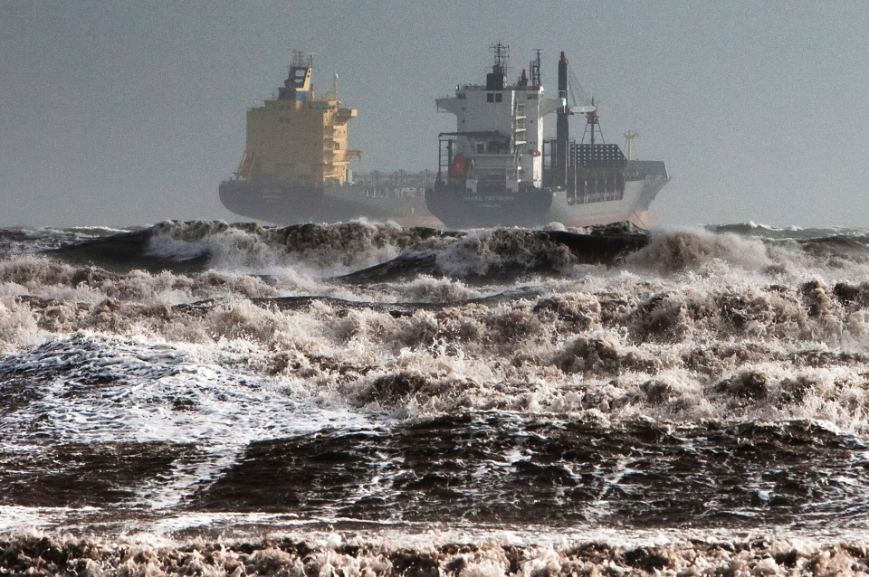 Two tankers are battered by gale winds while at the roadstead in the rough waters of the Gulf of Cagliari, Sardinia, Monday, Nov. 18, 2013. (AP / Max Solinas)
