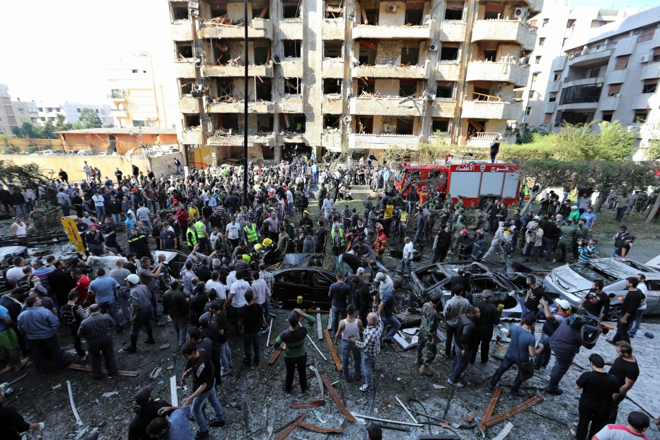 Lebanese people gather at the scene where two explosions have struck near the Iranian Embassy killing many, in Beirut, Lebanon, on Nov. 19, 2013. (AP / Bilal Hussein)