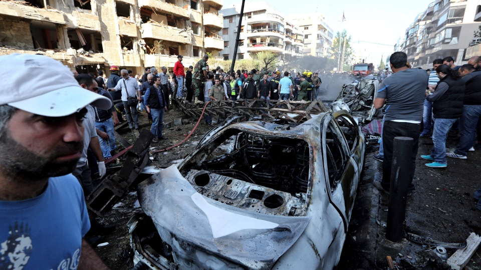 Lebanese people gather at the scene where two explosions have struck near the Iranian Embassy killing many, in Beirut, Lebanon, Tuesday, Nov. 19, 2013. (AP / Bilal Hussein)