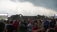 Crowds look at the aftermath of the Bluesfest stage collapse Sunday, July 17, 2011.