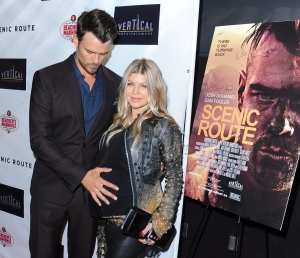 """Josh Duhamel, and his wife, Fergie, arrive on the red carpet for the premiere of """"Scenic Route"""" at the Chinese 6 Theater on Tuesday, Aug. 20, 2013 in Los Angeles. (Photo by Katy Winn/Invision/AP)"""