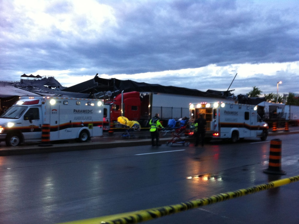 Paramedics work at the scene of the Bluesfest stage collapse Sunday, July 17, 2011.