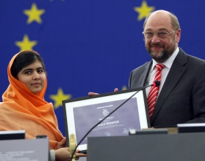 Pakistani schoolgirl Malala Yousafzai receives the Sakharov Prize 2013 from Martin Schulz, president of the European parliament, Wednesday Nov. 20, 2013, in Strasbourg eastern France. (AP / Christian Lutz)