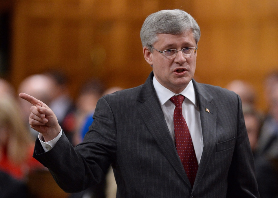 Prime Minister Stephen Harper responds to a question during question period in the House of Commons on Parliament Hill in Ottawa on Wednesday, Nov. 20, 2013. (Sean Kilpatrick / THE CANADIAN PRESS)