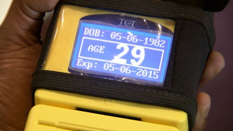 A scanner reads the birthdate and age from the driver's licence of a prospective gambler. July 18, 2011. (CTV)