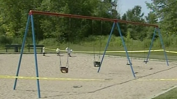 Yellow tape surrounds a park in Longueuil in order to prevent children from playing near sand wasps (July 19, 2011)