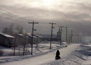 A snowmobile rides down the main street of the Fort Hope First Nation in northern Ontario in December 2012. (Ryan Remiorz / THE CANADIAN PRESS)
