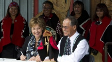 B.C. Premier Christy Clark, left, and Taku River Tlingit spokesperson John Ward sign a historic agreement outside the Joe Mathias Centre in North Vancouver, B.C., Tuesday, July 19, 2011. The agreement creates 13 newly-protected areas in more than three million hectares of the Atlin Taku region in northwestern B.C. (CP/Jonathan Hayward)