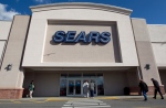 In this Feb. 22, 2012 file photo, shoppers enter a Sears department store location in Dedham, Mass. (AP Photo/Steven Senne, File)