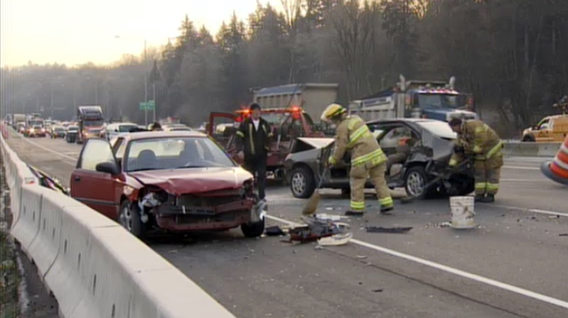 Emergency crews clean up debris after a major accident along Highway 1 that crippled westbound traffic on the major commuter route. Nov. 21, 2013. (CTV)