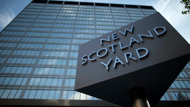 A sign rotates outside New Scotland Yard, the headquarters of London's Metropolitan Police, in central London. (AP Photo/Matt Dunham)
